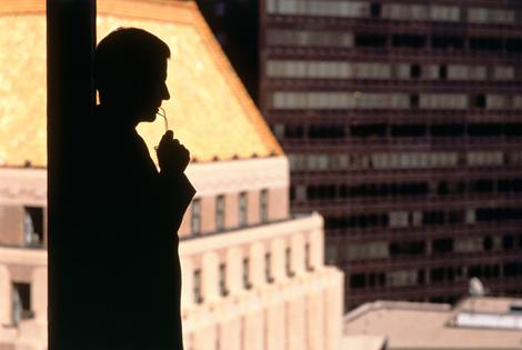 Silhouette of a businessman standing beside a wind