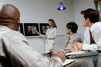 Business executives at a presentation in a confere